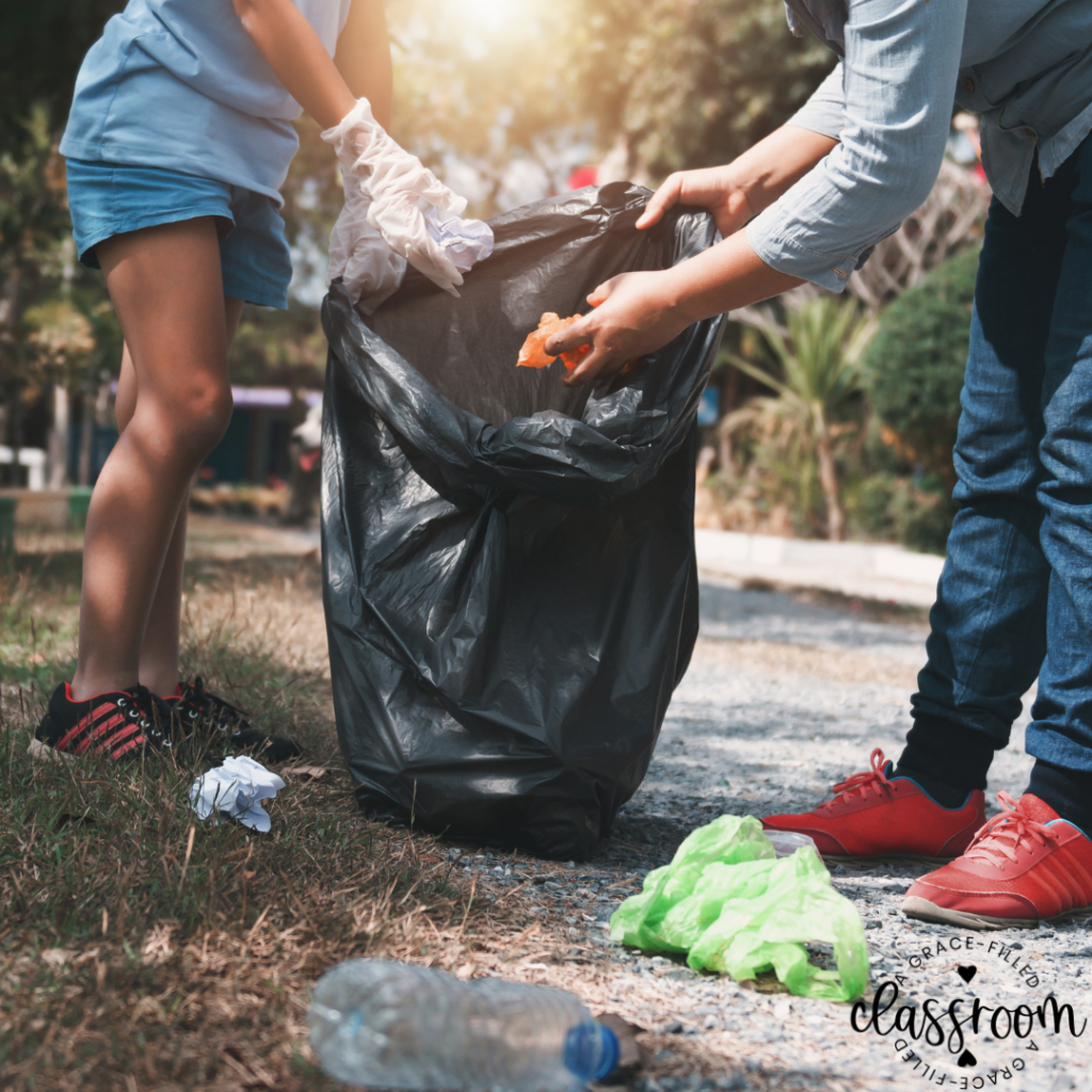 Image of students picking up trash and putting them in a trash bag. One tip for Celebrating Earth Day with Kids.