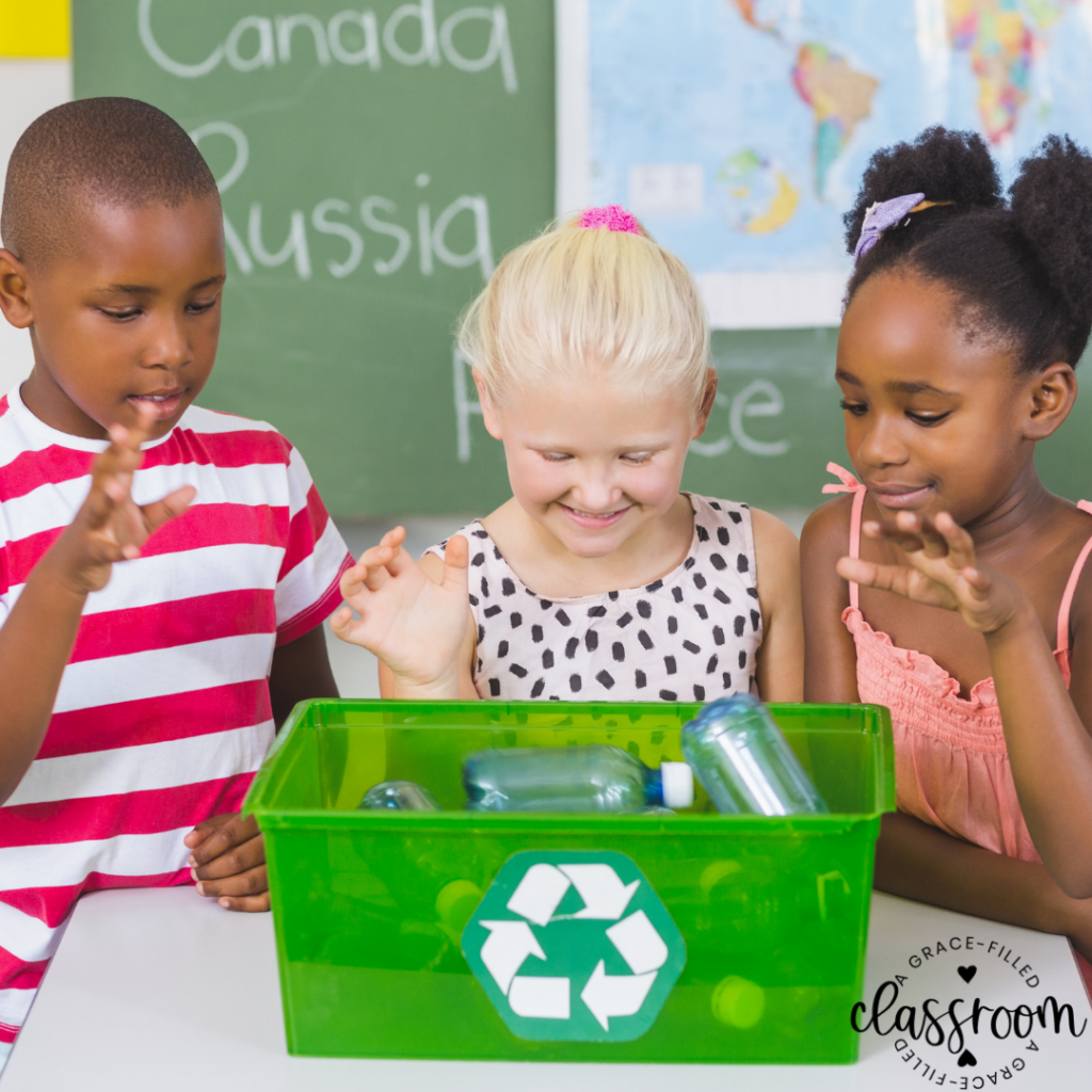 Three children are in a classroom looking down at a recycle bin after having added plastic bottles in the pin. Tip #2 for Celebrating Earth Day with Kids
